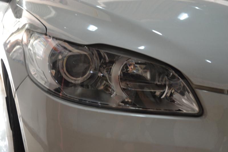 重庆标致301车灯改装透镜氙气灯天使眼